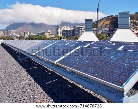 Solar panels or Solar cells on rooftop or terrace of building in Cape Town, South Africa. Can saving energy. Green or Sun or renewable or Clean energy. #714878728