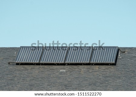 Solar panels - photovoltaic - panels on roof of family house,