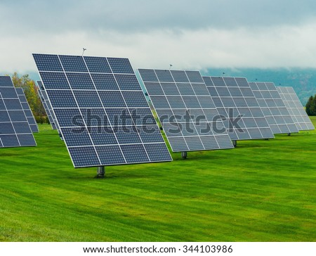 Solar panels placed on a countryside meadow. #344103986