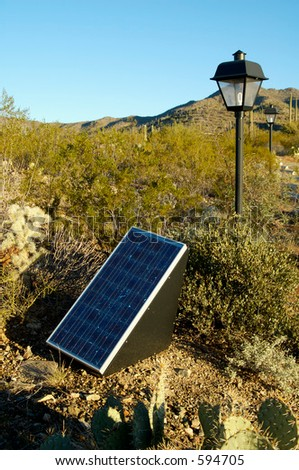 Solar panels used in the desert to provide electricity for lighting in a parking lot.