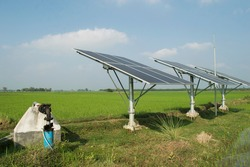 solar panels which can run submerge water pump for irrigation and distribution of water in agricultural paddy field in west bengal,India