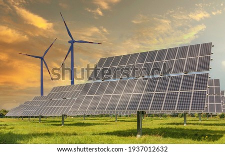 Solar panels wind turbines installed as renewable energy sources for electricity and power supply. Innovation and technology, environmental friendly energy. Solar farm under sunny day ストックフォト ©