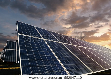 Solar panels with morning cloudscape background #552047110