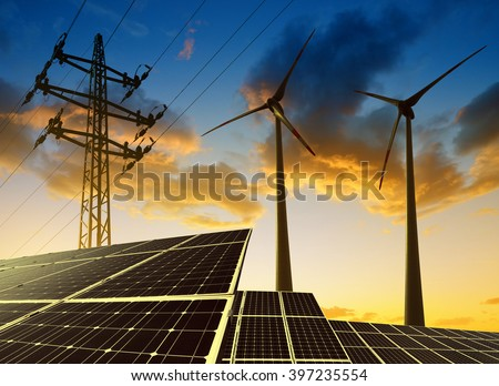 Shutterstock Solar panels with wind turbines and electricity pylon at sunset. Clean energy concept.