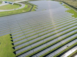 Solar Photovoltaic of aerial view, solar plant rows array of on the grass on the farm. Top view