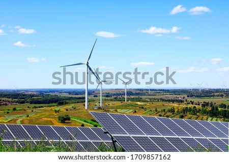 Solar photovoltaic panels and wind turbines. Energy concept ストックフォト ©
