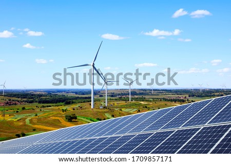 Solar photovoltaic panels and wind turbines. Energy concept Foto stock ©