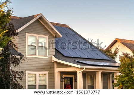 Solar photovoltaic panels on a house roof Photo stock ©