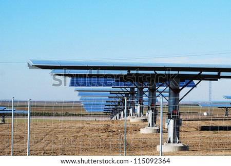 Solar photovoltaic panels on clear blue sky.
