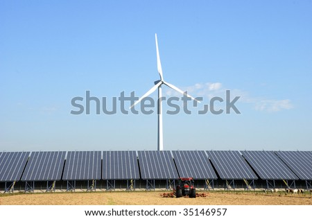 Solar plant with wind turbine at a farm in the Netherlands.