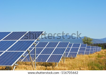 Solar power plant against a mountain landscape