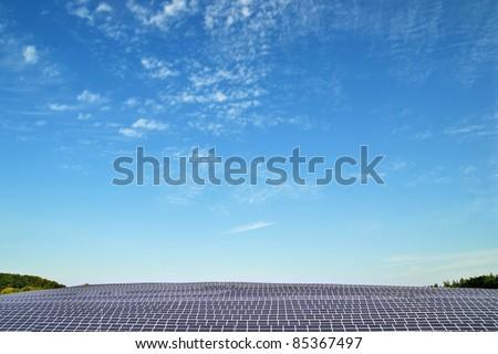 Solar power plant under blue sky