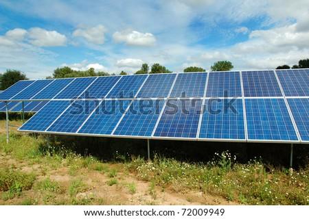 Solar power station below blue sky