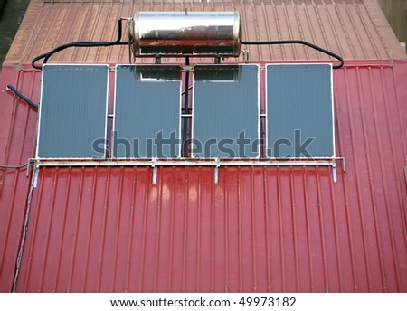 Solar powered water heating system mounted on a corrugated metal roof