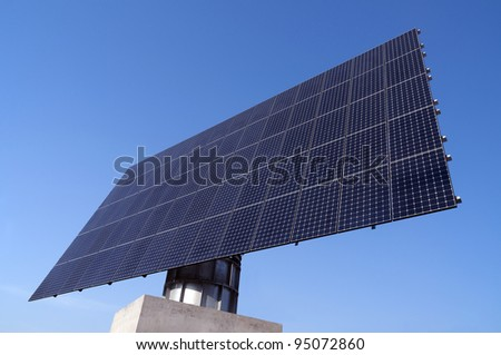 Solar Station With Many Solar Panels Against The Blue Sky - stock photo