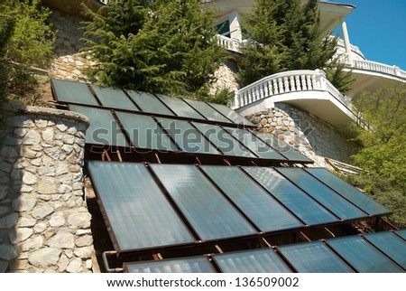 Solar system- green energy. A lot of panels in rows
