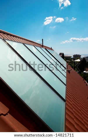 Solar water heating system (geliosystem) on the house roof.