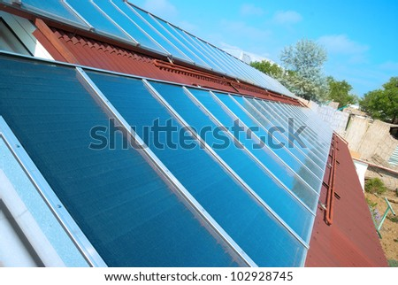 Solar water heating system on the red roof. Gelio panels.