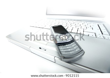 Solarized laptop and a modern flip up cellphone