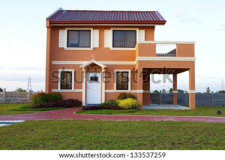 Sold Single family yellow orange  house with cyan sky background.