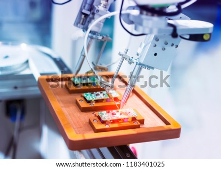 soldering iron tips of robotic system for automatic point soldering for printed and assembly electric circuit board ( PCB ) at factory