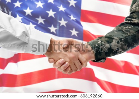Soldier and civilian shaking hands on USA flag background ストックフォト ©