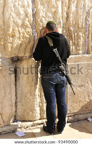 Soldier at the wailing western wall,  Jerusalem, Israel