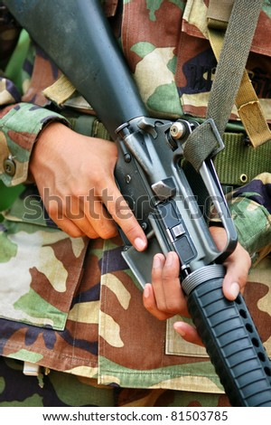 soldier carrying  M 16  in combat training