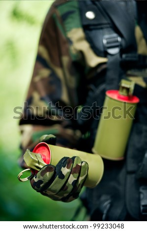 soldier carrying smoke bomb