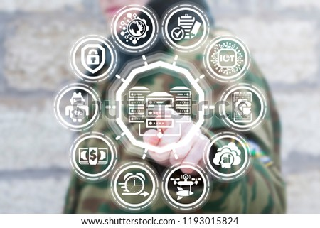 Soldier clicks a database servers icon on a virtual screen. Big data military center. Armed information technology. #1193015824