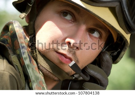 Soldier communicating with the base for new orders