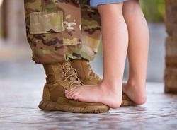 soldier dancing with child on his feet