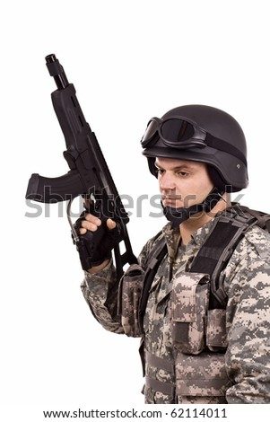 soldier holding a gun, isolated in white
