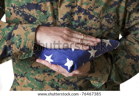 Soldier in Camouflage Holding Flag