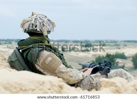 soldier in desert uniform at rest
