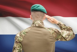Soldier in hat facing national flag series - Netherlands