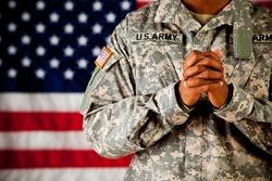 Soldier: Man In Uniform Praying