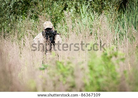 Soldier moving through grass