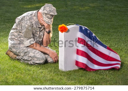 Soldier on american cemetery. Memorial Day concept