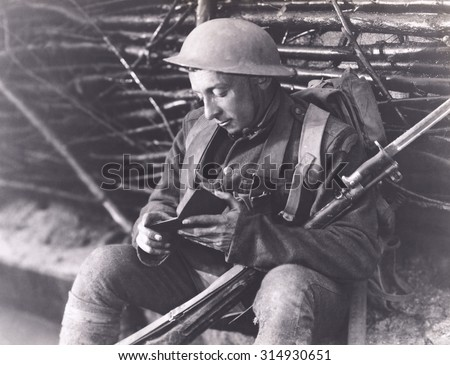 Soldier reading a book