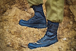 Soldier's boots on the feet of an Israeli soldier. Concept: Soldiers IDF - Israel Defense Forces (Tzahal),  IsraelI soldiers, Israeli army