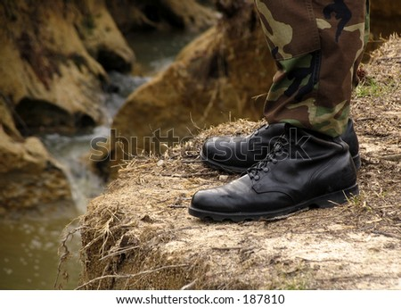 soldier's boots overlooking a cliff