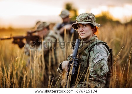 Soldier shooting with his weapon, rifle at sunset. War, army, military concept.