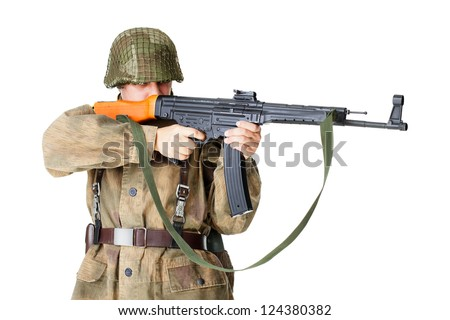 soldier shoots submachine gun isolated on white background