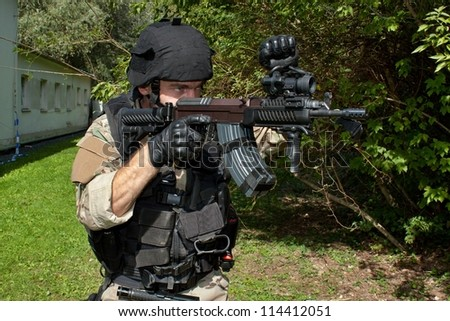 soldier special counterterrorism unit, sa.vz.58 with an assault rifle, caliber 7.62 mm, shows STOP signal