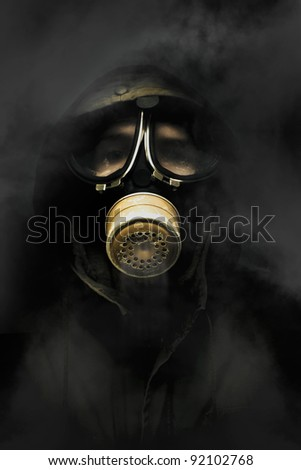 Soldier Standing In The Dead Of Night Breathing Through A Military Issued Gasmask While A Haze Of Toxic Gas And Smoke Circulate Around The Air