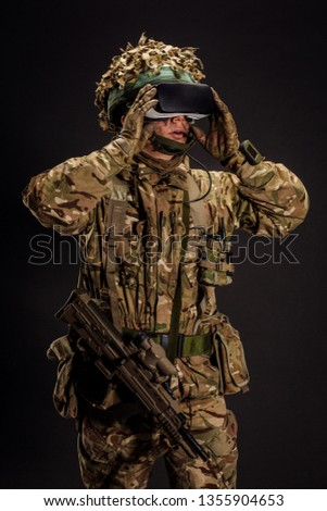 soldier use a VR glasses for combat simulation training. war, army, technology and people concept.