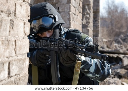 Soldier with a rifle targeting