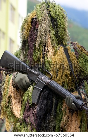 SOLDIER WITH AN AUTOMATIC RIFLE DISGUISED AS SNIPER