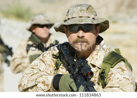 Soldier with assault rifles